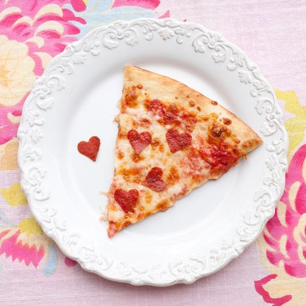 heart shaped pepperoni on pizza